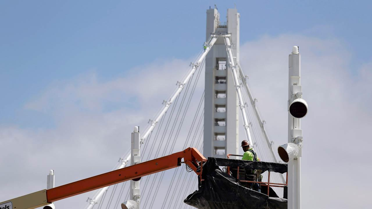 This photo taken Thursday, Aug. 1, 2013 shows a worker on the new eastern section of the San Francisco-Oakland Bay Bridge in San Francisco.