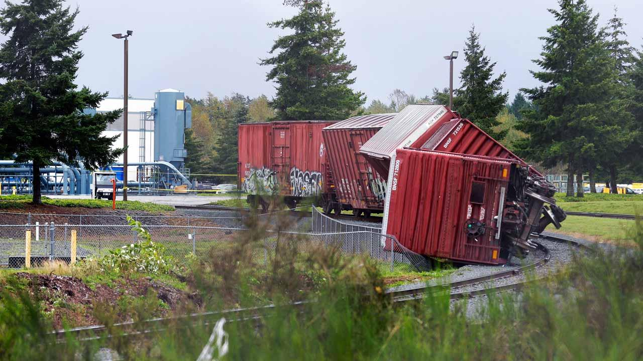 Rail cars are overturned near Boeings Frederickson facility in Puyallup, Wash., Monday, Sept. 30, 2013 after a tornado came through the area earlier in the morning. (AP Photo/Ted S. Warren)