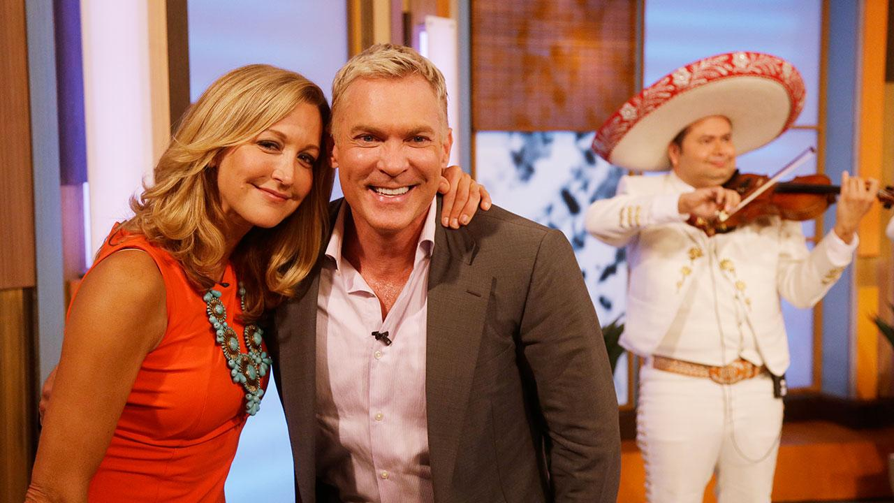 Lara Spencer, left, and Sam Champion of the ABC networks Good Morning America