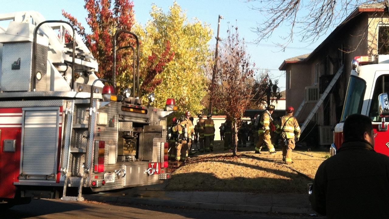 Fresno firefighters rescued three people from a fast moving apartment fire in Central Fresno. One other resident escaped, but was taken to a Fresno hospital for smoke inhalation. <span class=meta>(Amanda Venegas)</span>