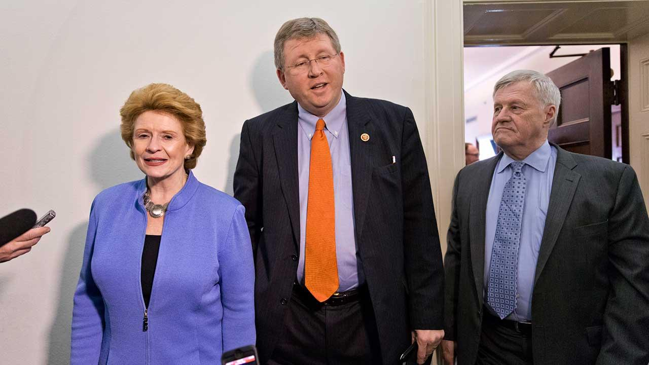 Senate Agriculture Committee Chair Sen. Debbie Stabenow, D-Mich., left, and House Agriculture Committee Chairman Rep. Frank Lucas, R-Okla.,