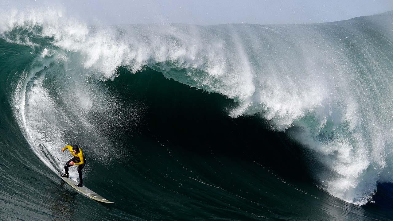 Greg Long competes during the third heat of the Mavericks Surf Competition in Half Moon Bay, Calif., Sunday, Jan. 20, 2013.