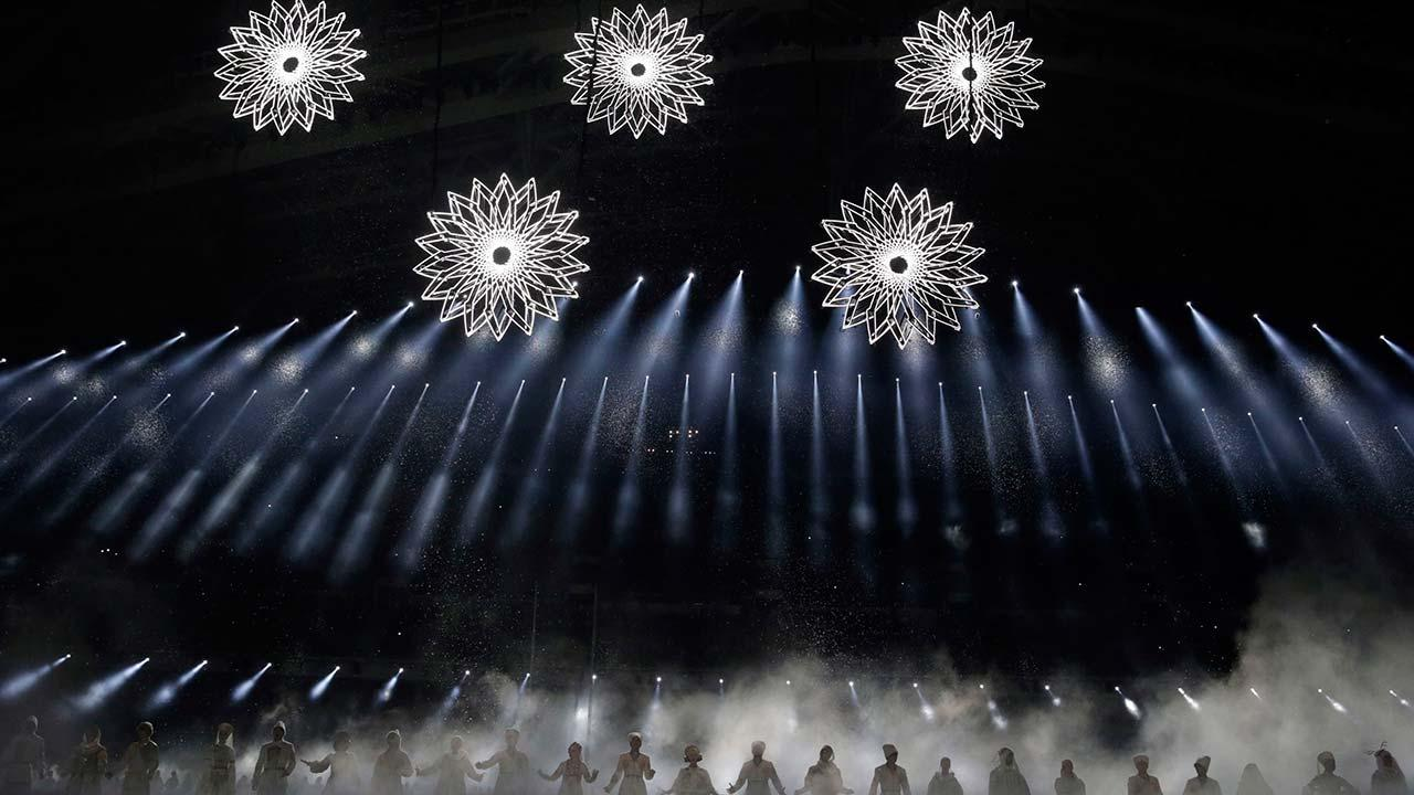 Artists perform as snow flakes start forming the Olympic rings during the opening ceremony of the 2014 Winter Olympics in Sochi, Russia, Friday, Feb. 7, 2014.