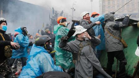 Anti-government protesters throw stones during clashes with riot police in Kievs Independence Square, the epicenter of the countrys current unrest, Kiev, Ukraine, Wednesday