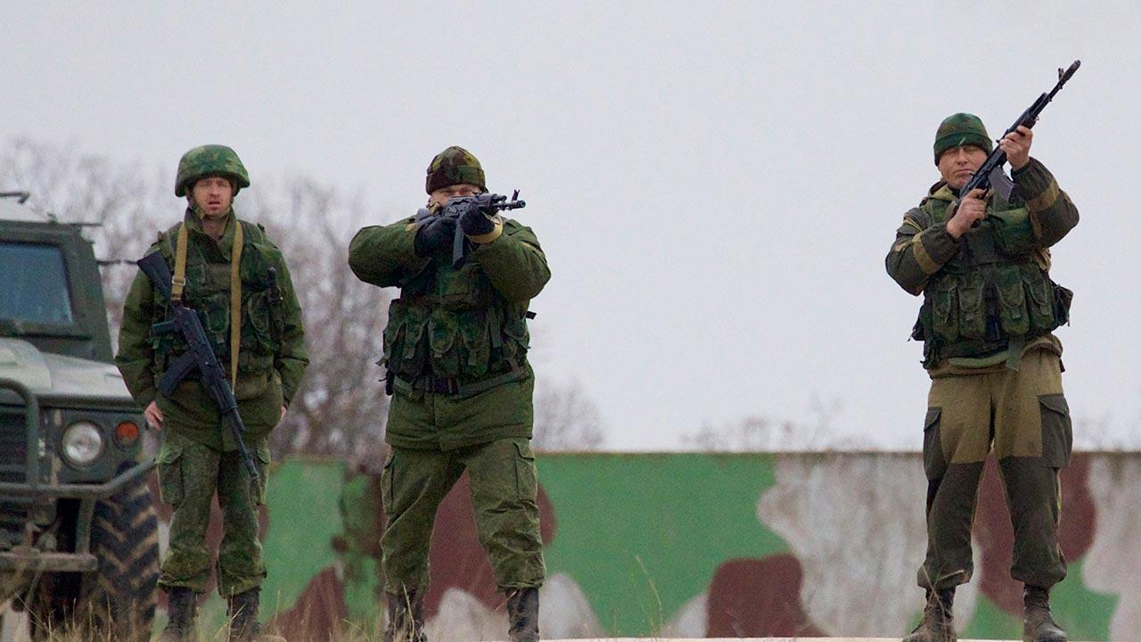Russian soldiers fire warning shots at the Belbek air base, outside Sevastopol, Ukraine