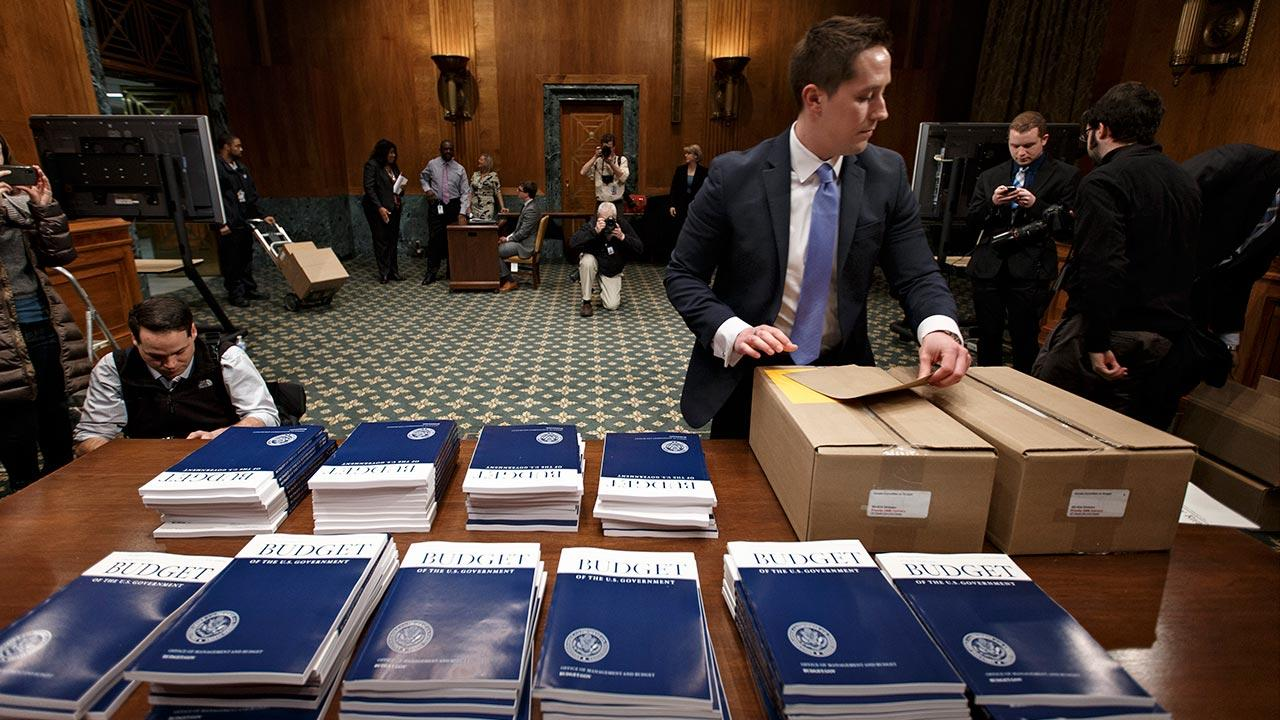 Copies of President Barack Obamas proposed fiscal 2015 federal budget are set out for distribution by Senate Budget Committee Clerk Adam Kamp, on Capitol Hill in Washington, Tuesday, March 4, 2014.
