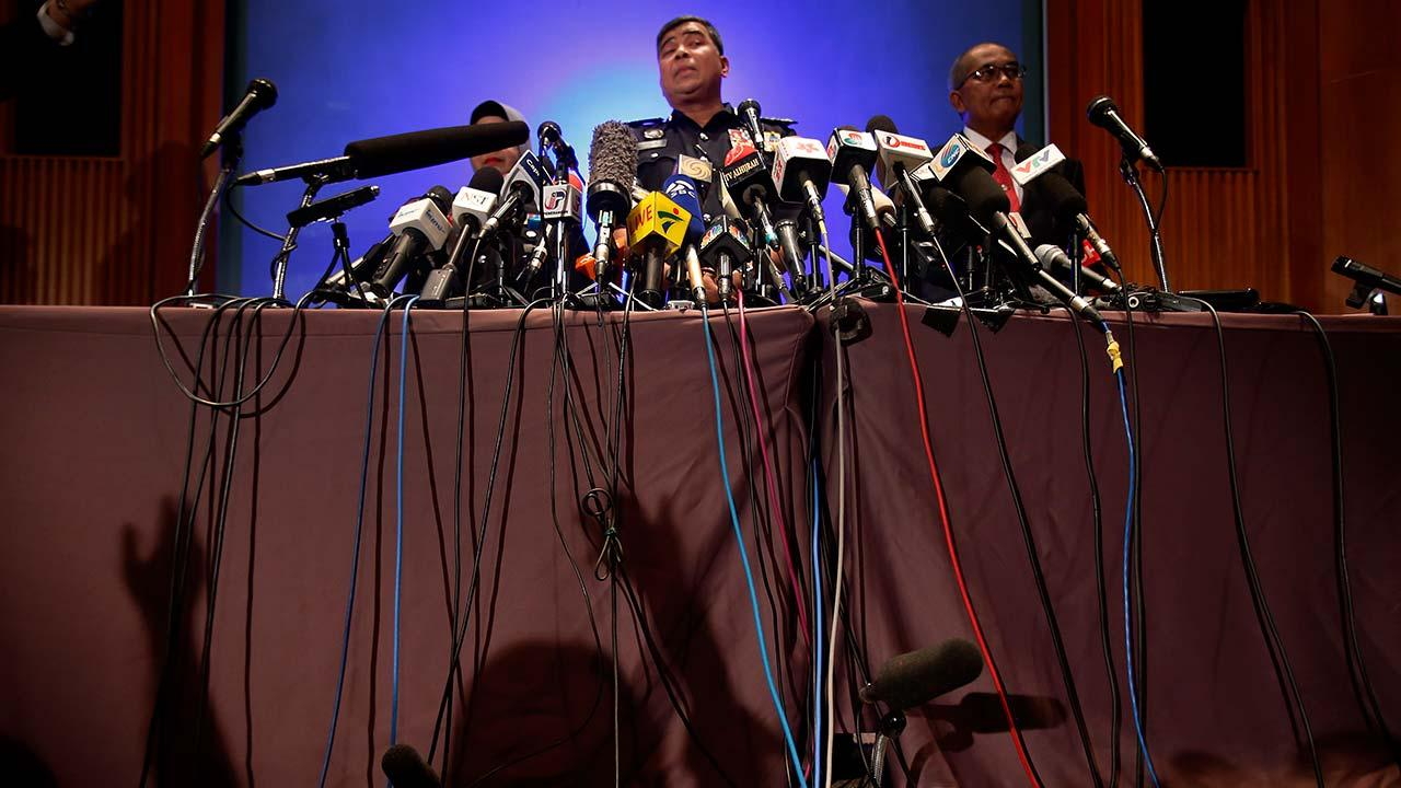 Malaysian police chief Khalid Abu Bakar answers questions from members of the media