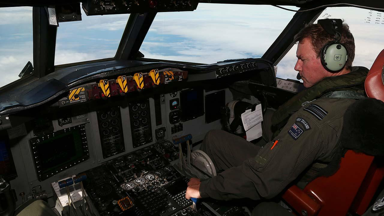 A Royal New Zealand Air Force P-3 Orions co-pilot and Squadron Leader Brett McKenzie controls the pane while searching for the missing Malaysia Airlines Flight MH370 in the southern Indian Ocean, Monday, March 31, 2014.