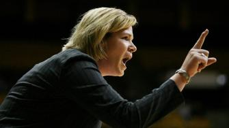 Northern Colorado head basketball coach Jaime White relays a play during a college basketball game against Wyoming at Arena Auditorium in Laramie, Wyo., Monday, Dec. 17, 2007.