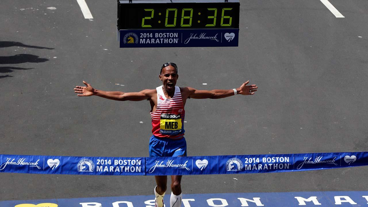 Meb Keflezighi, of San Diego, Calif., celebrates as he crosses the finish line to win the 118th Boston Marathon, Monday, April 21, 2014, in Boston.