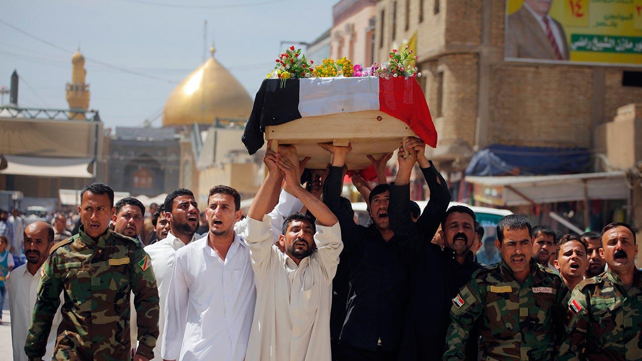 Mourners chant slogans against the al-Qaida breakaway group Islamic State of Iraq and the Levant
