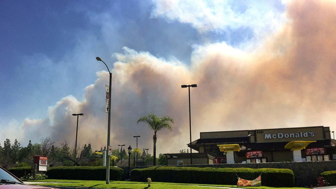 Smoke from a wildfire can bee seen in Rancho Cucamonga, Calif.,