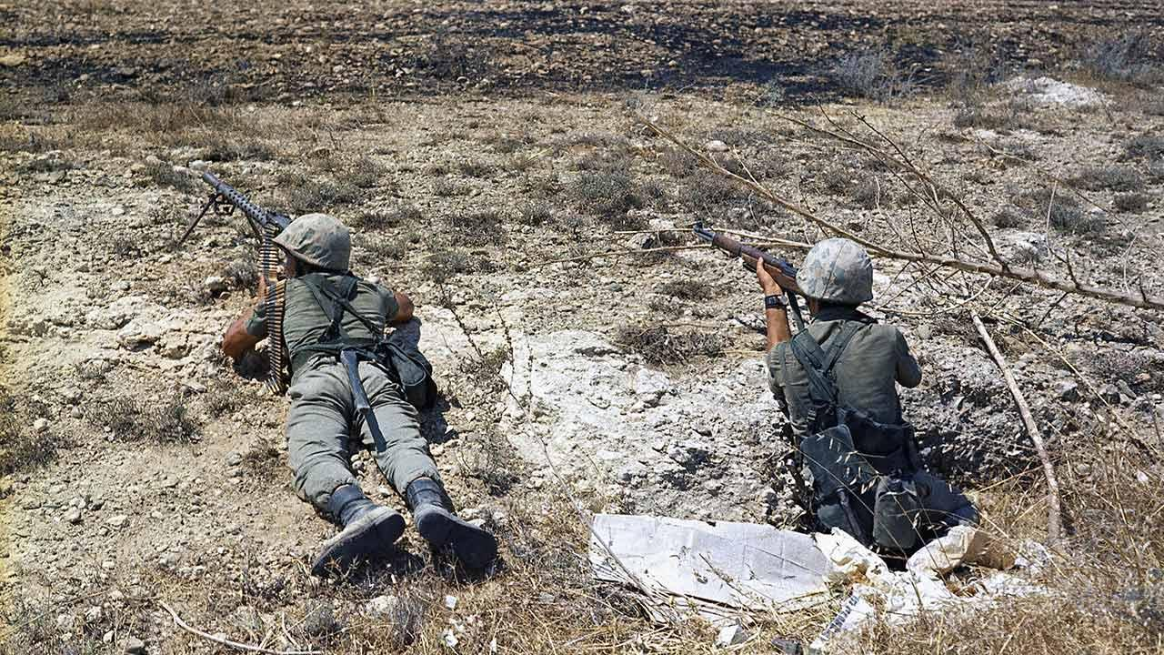 FILE - In this file photo dated July 25, 1974, Turkish troops in position on the frontline some 500 yards form the outer perimeter and 400 yards from Greek position at the Nicosia Airport, Cyprus. Europes top human rights court on Monday May 12, 2014, ordered Turkey to pay 90 million euros ($123 million) to Cyprus over the 1974 invasion of the island and its subsequent division, in one of the largest judgments in its history, saying that the passage of time did not erase responsibility in the case. The judgment comes as the Turkish and Greek Cypriot communities are engaged in renewed efforts to reunite the island