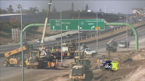 Crews work one of the Valley's busiest freeway interchanges