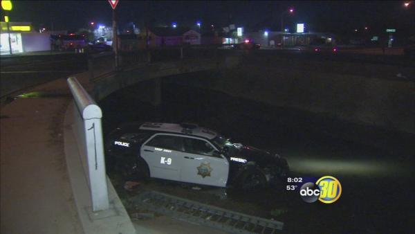 Crash sends Fresno police car into canal