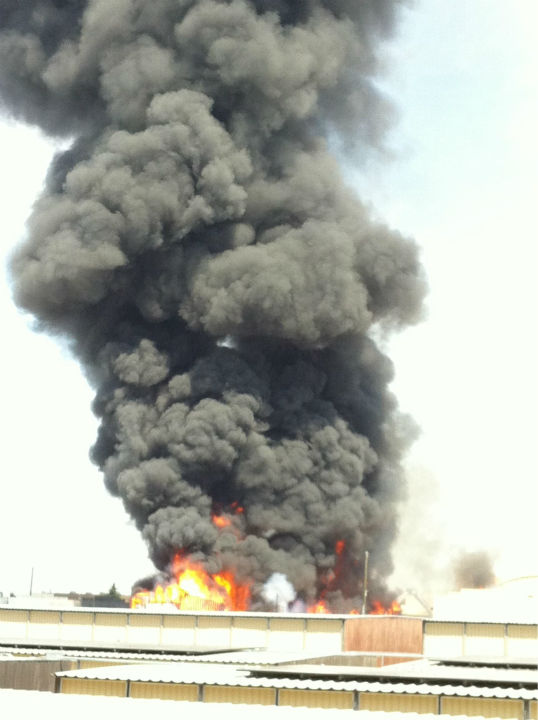 "<div class=""meta ""><span class=""caption-text "">A large fire at a Fresno storage facility sent a huge plume of black smoke into the air. (KFSN Photo/ uReport)</span></div>"