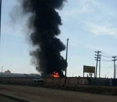 A large fire at a Fresno storage facility sent a huge plume of black smoke into the air. <span class=meta>(KFSN Photo&#47; uReport)</span>