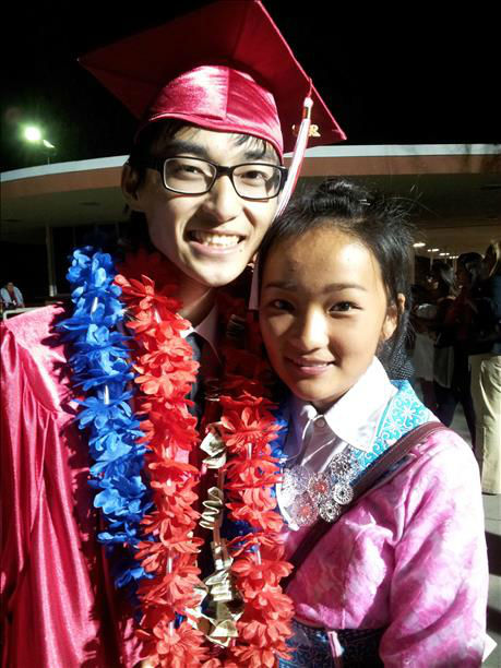 "<div class=""meta ""><span class=""caption-text "">Tshwm Sim Moua 2013 Graduate from Mclane High with his girlfriend. (KFSN Photo/ uReport)</span></div>"