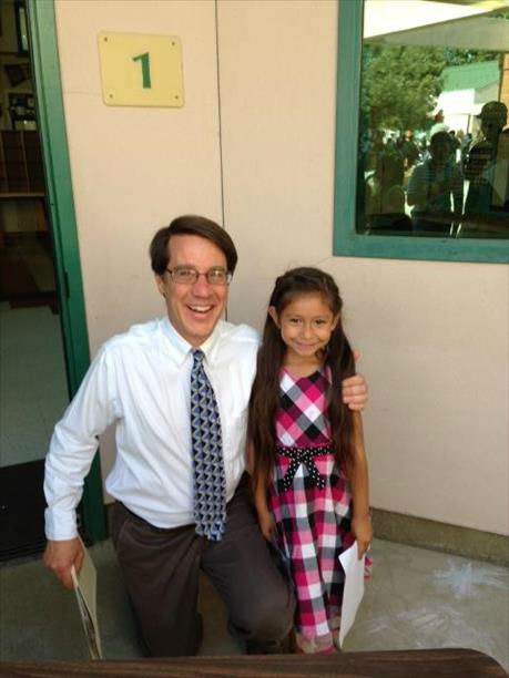 Lilyana and teacher Mr.D Kindergarden Grad Pioneer Elementary Merced Ca <span class=meta>(KFSN Photo&#47; uReport)</span>