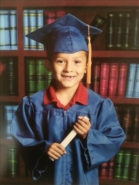 "<div class=""meta ""><span class=""caption-text "">Sebastian from Sanger Graduated from Wilson kindergarten (KFSN Photo/ uReport)</span></div>"