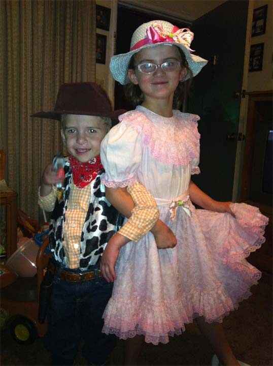 Good morning! Thought I&#39;d send in my kids Halloween costumes for this year both pretty much hand made by me, on the left my son hunter in his woody from toy story costume, age 5 and on the right my daughter Kiya in her little Bo peep costume age 6 also from toy story :&#41; Hope you can use this picture! Happy Halloween  <span class=meta>(The Washburn family - uReport)</span>