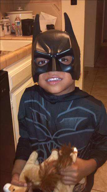 Roman as Batman