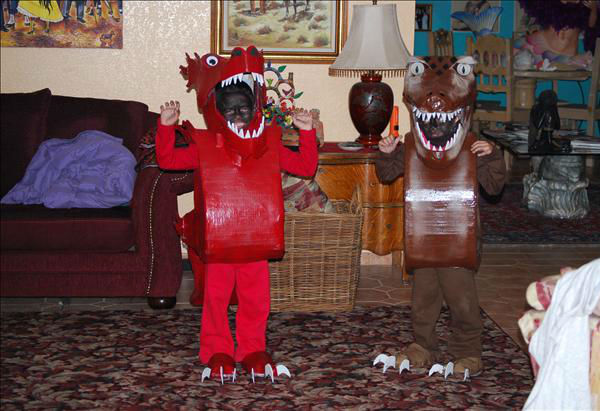 "<div class=""meta ""><span class=""caption-text "">Elliot as Pillow Pet T-Rex and Vincent as a Chinese dragon. (KFSN Photo/ uReport.abc30.com)</span></div>"