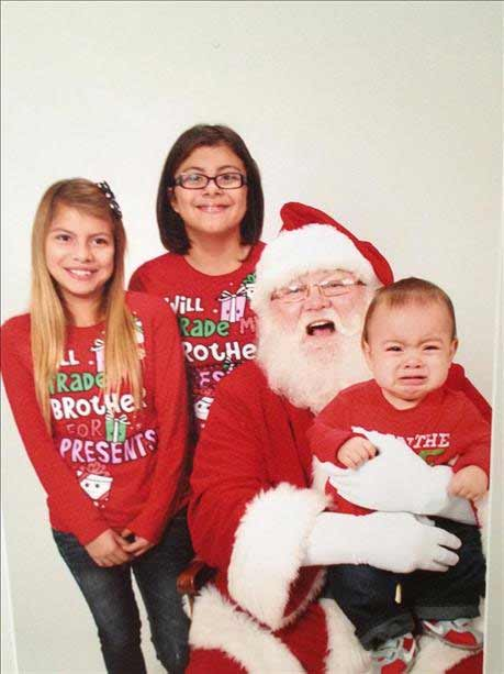 Andrew&#39;s first view of Santa was caught by surprise when the photographer thought it was best to sit him on Santa&#39;s lap without Andrew seeing him. Bad idea LOL <span class=meta>(Melissa Gonzales)</span>
