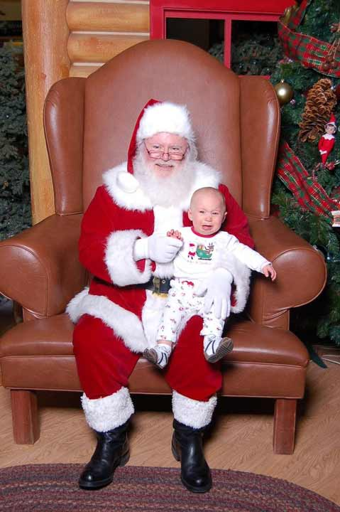 "<div class=""meta ""><span class=""caption-text "">Here is a photo of my youngest son, Nickolis, who is 10 months old seeing Santa for the 1st time. Needless to say he was not happy and was scared of Santa :( (Miranda Hatch)</span></div>"