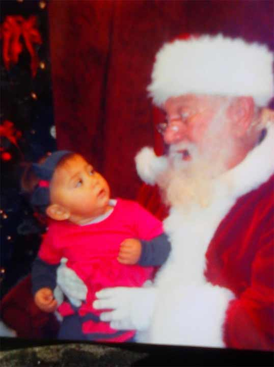 This is my granddaughter, Moon. It looks as though Santa was telling her to be a good girl! At 16 months, that&#39;s easier said than done!! <span class=meta>(Renee Clark)</span>