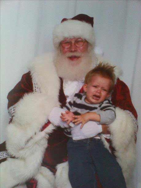 This is my little cry baby JORDAN he wasnt to happpy haha lol. Santa was a troooper tho.. merrry xmas everyone!! <span class=meta>(HisMomma10 - uReport)</span>