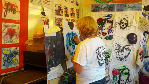Custom-painted t-shirts at the fair. <span class=meta>(Anonymous)</span>