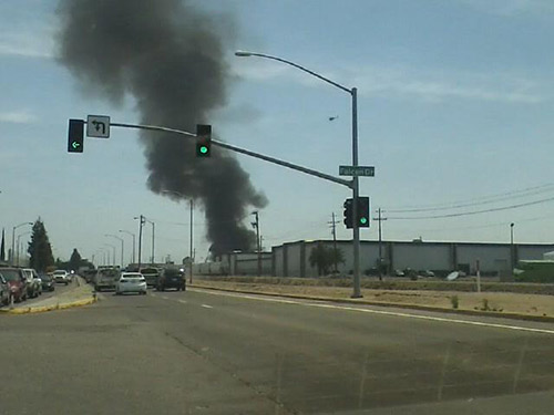 A large fire at a Fresno storage facility sent a huge plume of black smoke into the air. <span class=meta>(Facebook &#47; Cindy Jackson-Flores)</span>