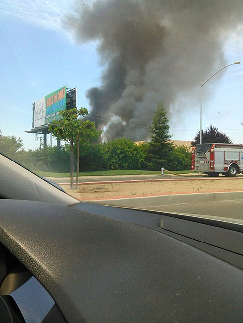 A large fire at a Fresno storage facility sent a huge plume of black smoke into the air. <span class=meta>(Facebook &#47; Maria V. Lucio)</span>