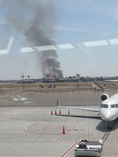 View of the large fire from Fresno Yosemite International Airport. <span class=meta>(Facebook &#47; Serina Ramirez Montes)</span>