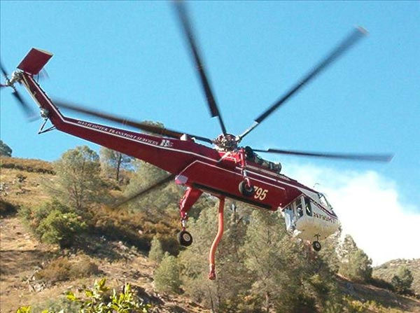 This is the crane helicopter taking on water to fight the motor fire in Mariposa. <span class=meta>(hdearing)</span>