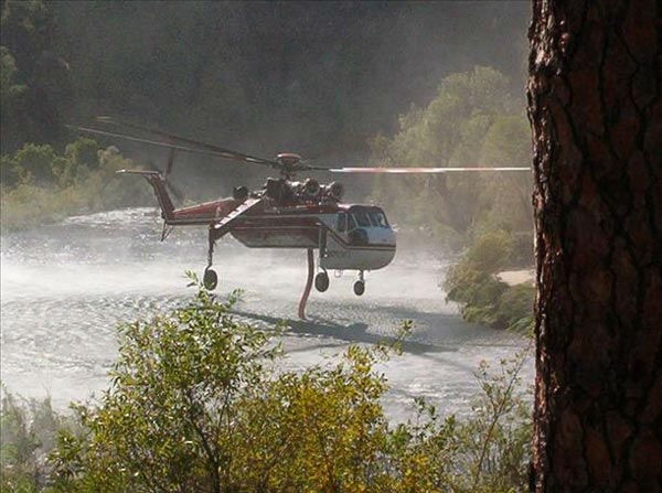 This is the crane helicopter taking on water to fight the motor fire in Mariposa. <span class=meta>(KFSN Photo&#47; uReport)</span>
