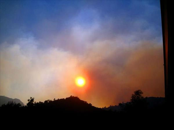 "<div class=""meta ""><span class=""caption-text "">My husband & I live in El Portal, just up the road from where the fire is burning. We can see it the smoke just over the hill from our apartment. Our electricity was turned back on around 1am this morning. (Cindy Miller)</span></div>"