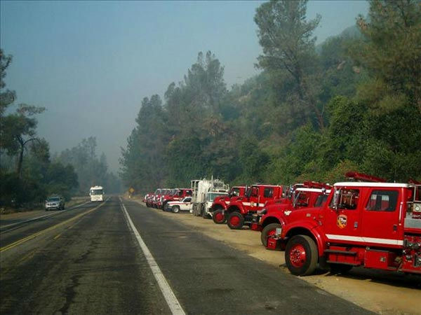 8-28-11 A row of fire vehicles parked across from a hotel in El Portal.  All of us from El Portal respect and appreciate everything these guys are doing!  They put themselves in harms way to protect us!  Thank You So Much!!!!!  Taken in El Portal <span class=meta>(wingsofangels)</span>
