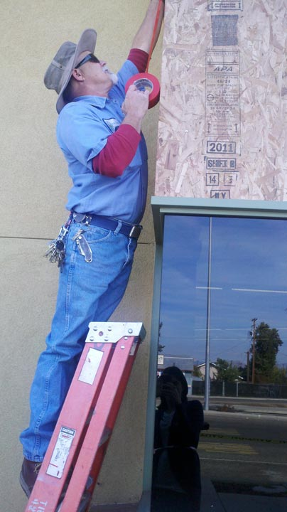 "<div class=""meta ""><span class=""caption-text "">Worker boarding up a window.  (Linda Mumma)</span></div>"