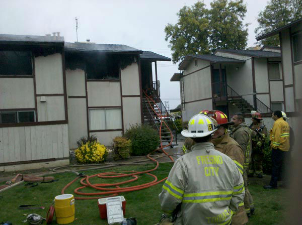 "<div class=""meta image-caption""><div class=""origin-logo origin-image ""><span></span></div><span class=""caption-text"">Two families living in those apartments have been displaced as a result of the flames.  (KFSN Photo)</span></div>"