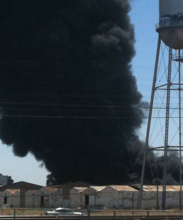 "<div class=""meta image-caption""><div class=""origin-logo origin-image ""><span></span></div><span class=""caption-text"">The black plumes of smoke is visible from much of Fresno and the surrounding area. The Fresno County Fire Department is attempting to douse the flames with large water tankers. (Lalo Garcia)</span></div>"