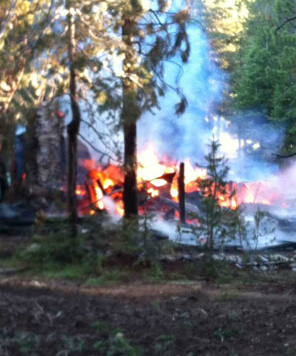 "<div class=""meta image-caption""><div class=""origin-logo origin-image ""><span></span></div><span class=""caption-text"">Cal Fire reported that a cabin was fully engulfed in flames and surrounding trees were burning in a fire at Huntington Lake. (KFSN Photo/ Gary Schoelen)</span></div>"