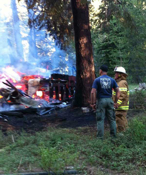 "<div class=""meta ""><span class=""caption-text "">Cal Fire reported that a cabin was fully engulfed in flames and surrounding trees were burning in a fire at Huntington Lake. (KFSN Photo/ Gary Schoelen)</span></div>"