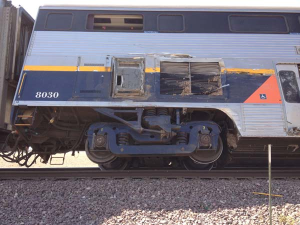 One train car has derailed and two other cars are at a 45 degree angle at 10th Avenue and Kansas Avenue near Hanford, according to the Kings County Fire Department.