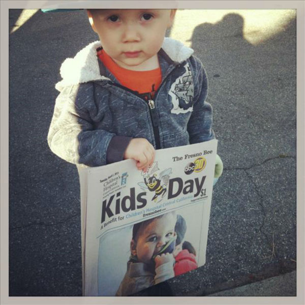 "<div class=""meta image-caption""><div class=""origin-logo origin-image ""><span></span></div><span class=""caption-text"">Benjamin Rios who will be 2 tomorrow from Hanford picked up his first kids day newspaper he recently just had tubes put in at valley children's they were great all around!!! (KFSN Photo/ uReport)</span></div>"