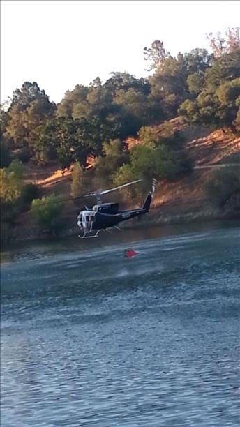 Yosemite Lakes Park Fires - June 12th | Chopper taking water directly from Yosemite Lakes Park Lake to fight the fires. <span class=meta>(KFSN Photo&#47; uReport &#47;  Shaun Hoffman)</span>