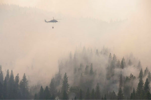 California Air and Army National Guard out in force in support of U.S. Forest Service and CAL FIRE battling the #Rimfire.Photos show helibase, 1-140th Aviation Brigade &#40;Air Assault&#41;, 129th Rescue Wing, cloud coverage, fires, and more. Shots were taken from UH-60 Black Hawk belonging to the California Army National Guard?s 1-140th Aviation Battalion at the Rim Fire near Yosemite, Aug. 22, 2013. <span class=meta>(U.S. Air National Guard photo by Master Sgt. Julie Avey&#47;Released)</span>