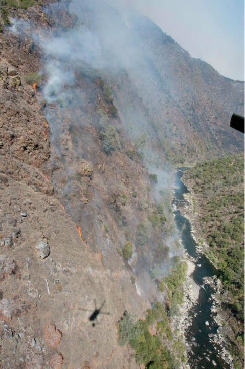 "<div class=""meta ""><span class=""caption-text "">The California Army National Guard's 1-140th Aviation Brigade (Air Assault) battles the #Rimfire in a UH-60 Black Hawk near Yosemite, Aug. 23, 2013. California Air and Army National Guard out in force in support of U.S. Forest Service and CAL FIRE. (U.S. Air National Guard photo by Master Sgt. Julie Avey/Released)</span></div>"