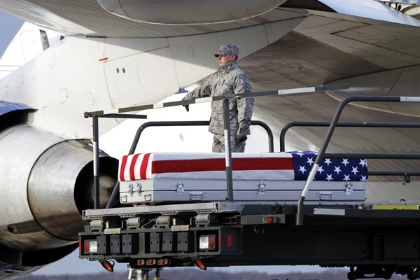 The transfer case containing the remains of Marine Sgt. Matthew T. Abbate of Fresno, Calif., is lowered upon arrival at Dover Air Force Base, Del. on Saturday, Dec. 4, 2010. The Department of Defense announced the death of Marine Sgt. Matthew T. Abbate who was supporting Operation Enduring Freedom in Afghanistan. <span class=meta>(AP Photo, Jose Luis Magana)</span>